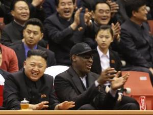 Kim Jong Un and Dennis Rodman watch North Korean and US players in an exhibition basketball game at an arena in Pyongyang, North Korea, Feb. 28, 2013.