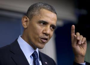 President Obama gestures as he speaks to reporters in the White House briefing room.