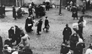 In this 1943 photo provided by the US Holocaust Memorial Museum courtesy of George Kadish/Zvi Kadushin, Jews are gathered at an assembly point in the Kaunas ghetto in  Lithuania.