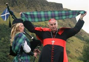 Cardinal Keith O'Brien unveils the worlds first Papal visit plaid, the St Ninian's Day Tartan, near the Scottish parliament in Edinburgh, Scotland, Thursday Sept.  9, 2010.