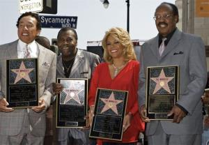 Miracles members, from left: Smokey Robinson, Pete  Moore, Claudette Robinson, and Bobby Rogers are honored with a star on the Hollywood Walk of Fame in 2009.