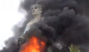 In this image taken from video, a statue of Hafez Assad, father of Syrian President Bashar Assad, burns after being set on fire by rebel fighters in Al-Raqqa, Syria, Monday, Feb. 11, 2013.