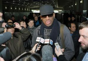 Former NBA star Dennis Rodman speaks to the media at the Pyongyang Airport in Pyongyang, before he leaves North Korea Friday, March 1, 2013.