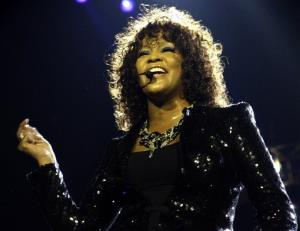 This April 25, 2010 file photo shows U.S singer Whitney Houston performing at the o2 in London as part of her European tour.