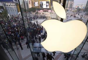 In this Oct. 20, 2012 photo, people line up to enter a newly-opened Apple Store in Wangfujing shopping district in Beijing.