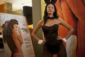A model dressed as a Playboy bunny poses with the first Hebrew language edition of the popular men's magazine.