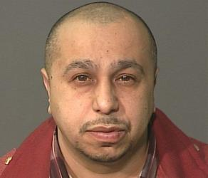 This undated photo, provided by the New York City Police Department on Monday March 4, 2013, shows Julio Acevedo, 44.
