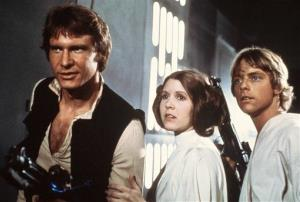 This file publicity image provided by 20th Century-Fox Film Corporation shows Harrison Ford, as Han Solo, Carrie Fisher, as Princess Leia Organa, and Mark Hamill, as Luke Skywalker, in Star Wars.