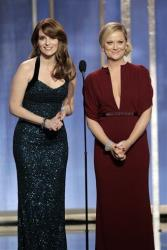 This image released by NBC shows co-hosts Tina Fey and Amy Poehler on stage during the 70th Annual Golden Globe Awards held at the Beverly Hilton Hotel on Jan. 13, 2013, in Beverly Hills, Calif.