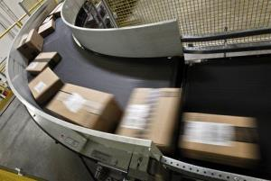 Packages ready to ship move along a conveyor belt at an Amazon.com facility in Phoenix.