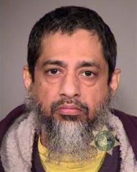 A photo provided by the Multnomah County Sheriff made  on March 5, 2013, in Portland, Ore., shows Reaz Qadir Khan.