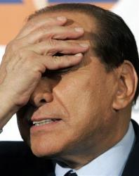 In this Oct. 6, 2005 file photo, Italian Premier Silvio Berlusconi touches his face during a joined press conference in Rome.