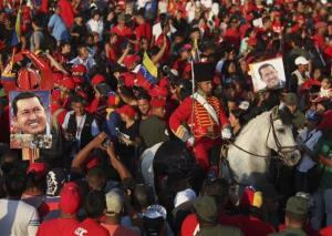 A member of the presidential guard rides on a horse at the front of a procession carrying the body of Venezuela's late President Hugo Chavez in Caracas, Venezuela, Wednesday, March 6, 2013.