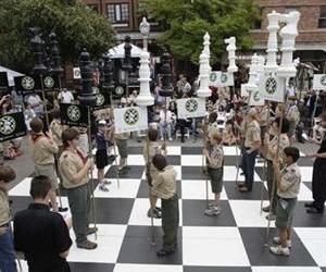 Boy Scouts stand on a giant chess board in this photo originally released to promote the Scouts' chess merit badge.