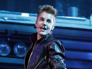 In this Sept. 30, 2012 file photo, Justin Bieber performs at the MGM Grand Garden Arena in Las Vegas.