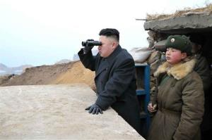 Kim Jong Un, center, looks at the South's territory from an observation post in the southernmost part of the southwestern sector of North Korea's border with South Korea.