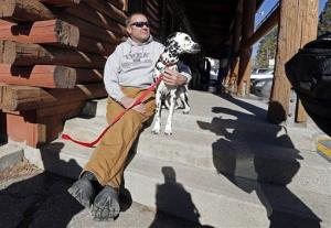 Rick Heltebrake, 61, a Boy Scout camp ranger, with his 4-year-old dalmation Suni on Feb. 13, 2012.