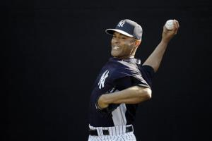 New York Yankees' Mariano Rivera pitches during a workout at spring training Feb. 16 in Tampa.