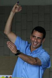 Miranda's  Gov. Henrique Capriles shows his finger marked after casting his ballot at a polling station in Caracas, Venezuela, Sunday, Dec. 16, 2012.