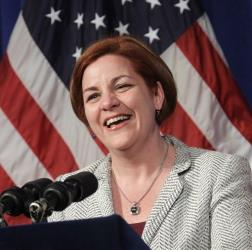 City Council Speaker Christine Quinn laughs during a news conference at city hall in New York, Wednesday, May 9, 2012.