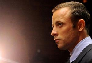 In this photo taken Friday, Feb. 22, 2013 Olympic athlete, Oscar Pistorius, in court in Pretoria, South Africa.