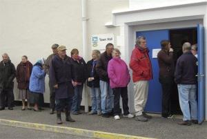 People line waiting for a polling station to open to vote in Port Stanley, Falkland  Islands.