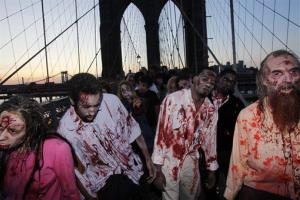 Costumed actors, promoting the Halloween premiere of the AMC television series The Walking Dead, shamble along the Brooklyn Bridge in 2010.