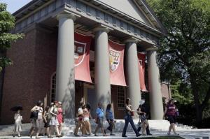 People are led on a tour group at the campus of Harvard University in Cambridge, Mass. Thursday, Aug. 30, 2012.