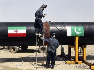 Iranian workers weld gas pipes together at the start of construction on a pipeline to transfer natural gas from Iran to Pakistan, in southeastern Iran, near the Pakistani border, March 11, 2013.