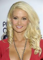 In this Oct. 12, 2008 file photo, model Holly Madison poses on the press line at the Hollywood Life 5th Annual Hollywood Style Awards in Los Angeles.