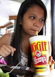A customer drinks a 24-ounce soda at Wendy's.
