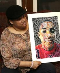 Lisa Williamson holds up a self-portrait of her son Brandon Murray, Monday, March 11, 2013, in Warren, Ohio.