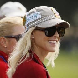 Tiger Woods' then-wife Elin Nordegren watches her then-husband play in his foursomes match at the Presidents Cup at Harding Park Golf Course Thursday, Oct. 8, 2009, in San Francisco.