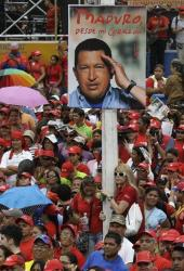 Supporters of Venezuela's acting President Nicolas Maduro gather outside the national electoral council as he registers his candidacy for president in Caracas, Venezuela, Monday, March 11, 2013.