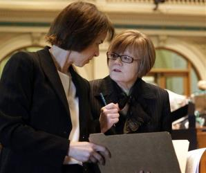 Rep. Claire Levy, D-Boulder, and Rep. Dickie Lee Hullinghorst, D-Longmont,  confer as the Civil Unions bill is debated.
