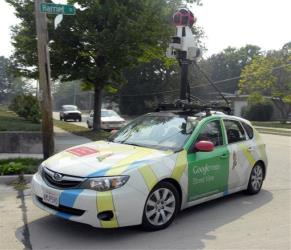 A Google car with roof-mounted digital imaging equipment circles neighborhoods in Racine, Wisconsin.