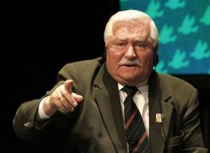 In this Monday, April 23, 2012 file photo former Polish President Lech Walesa speaks during a panel discussion at the World Summit of Nobel Peace Laureates, in Chicago.