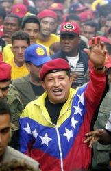 In this 2002 file photo, Venezuela President Hugo Chavez waves to supporters in Caracas.