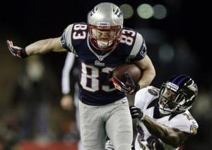 New England Patriots wide receiver Wes Welker runs out of the tackle of Baltimore Ravens free safety Ed Reed.