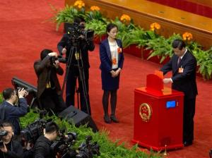 Xi Jinping casts his votes at a plenary session of the National People's Congress in Beijing Thursday, March 14, 2013.