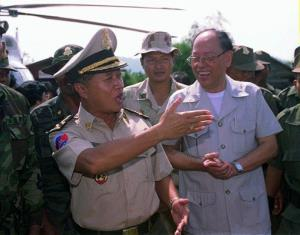 In this Nov. 14, 1996 file photo, Cambodia's then First Prime Minister Prince Norodom Ranariddh, left, chats with dissident Khmer Rouge leader Ieng Sary, right, upon his arrival at Malai, Cambodia.