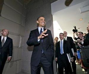 President Barack Obama turns to reporters as he leaves  Capitol Hill, March 13, 2103, after his closed-door meeting with House Speaker John Boehner and Republican lawmakers to discuss the budget.