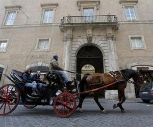 A horse-and-carriage goes past the building of the Domus Internationalis Paulus VI hotel, where Cardinal Jorge Mario Bergoglio stayed before entering the conclave and being elected Pope.