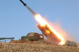 A rocket launcher is fired during a live drill by the Jangjae Islet Defense Detachment and the Mu Islet Hero Defense Detachment deployed in the southwestern sector of North Korea.