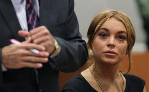 Lindsay Lohan appears in Los Angeles court with her new attorney Mark Heller, left, for a pretrial hearing, Wednesday, Jan. 30, 2013.