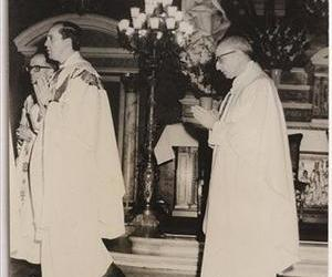 In this 1973 photo released by the El Salvador School, priest Jorge Mario Bergoglio, right, and priest Pedro Arupe give a Mass at the church in the El Salvador school in Buenos Aires, Argentina.