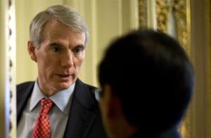In this Feb. 26, 2013 file photo, Sen. Rob Portman, R-Ohio , left, pauses to talk on Capitol Hill in Washington.