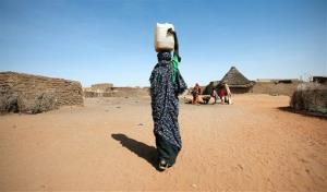 A woman carries water in Africa.