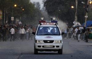 In this March 1 photo, Indian protesters attack a police vehicle with stones during a protest against the rape of a 7-year-old girl in New Delhi.