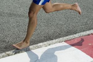 A barefoot runner.